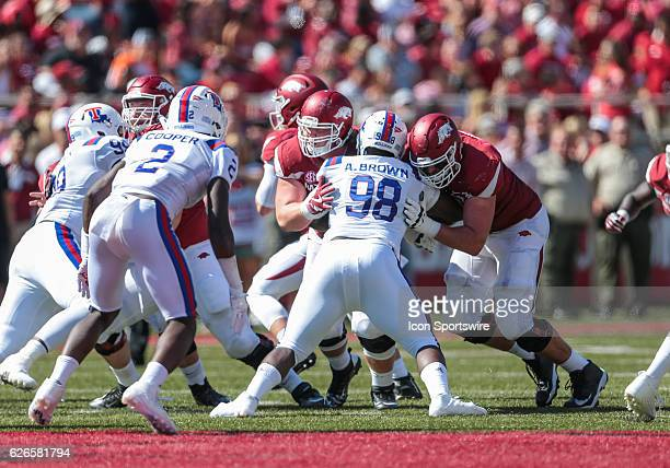 Louisiana Tech Bulldogs defensive lineman Aaron Brown tries to penetrate the Arkansas Razorbacks offensive line during an NCAA football game between...