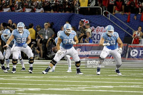 North Carolina Tar Heels center Lucas Crowley offensive lineman Caleb Peterson and offensive tackle Bentley Spain in second half action The Georgia...