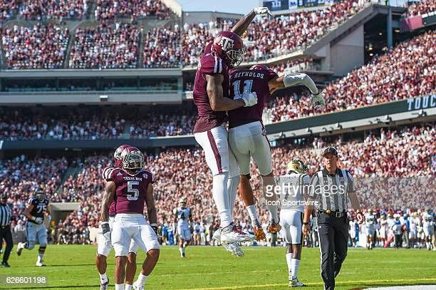Texas AM Aggies wide receiver Ricky SealsJones and wide receiver Josh Reynolds celebrate a touchdown during the UCLA Bruins vs Texas AM Aggies game...