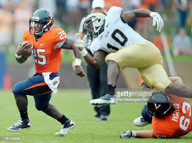 Virginia's Kevin Parks left picks up a 1st quarter 1st down as WM's Jabrel Mines center is taken out of the action by Virginia's offensive guard...