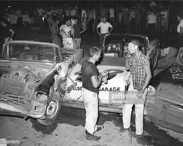 Larry Frank discusses the situation with another driver after a huge 14car crash late in the NASCAR Convertible Series race at AshevilleWeaverville...