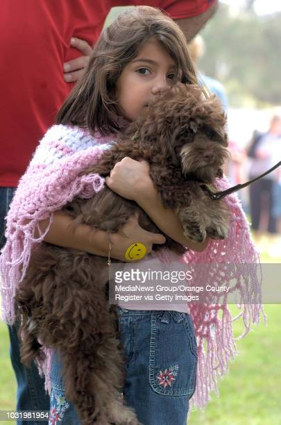 September 30 2006 Carolina Moraga holds on Ruby a 6 monthsold cockapoo during the Walk to Save the Animals at Heartwell Park in Long Beach Calif on...