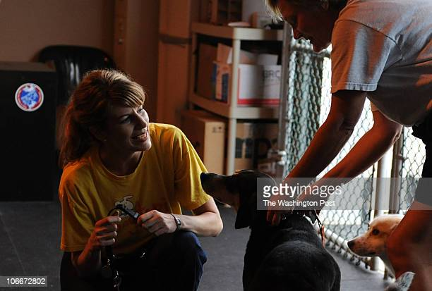 September 30, 2008 PLACE: Woodbridge, VA CREDIT: jahi chikwendiu/twp Amber Sutton, left, releases dogs to their owner, Ruth Biehl at Dogtopia of...