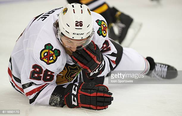Chicago Blackhawks left wing PierreCedric Labrie falls to the ice with an injury during a NHL preseason game between the Pittsburgh Penguins and the...