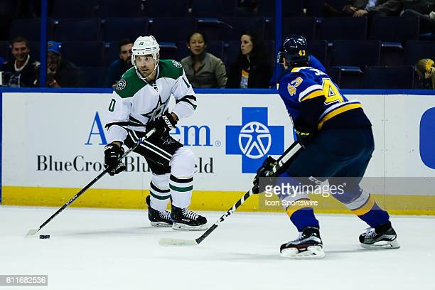 Dallas Stars left wing Patrick Sharp looks for an open man while being shadowed by St Louis Blues defenseman Jordan Schmaltz during the first period...