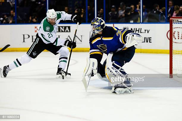 St Louis Blues goalie Pheonix Copley gets caught on the wrong side of the net as Dallas Stars right wing Brett Ritchie moves in during the third...