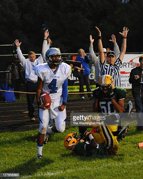 All the hands go up as Sherwood QB Jordan Larsen scooted into the endzone after he caught his own batted pass in the 2nd quarter on September 30 2011...