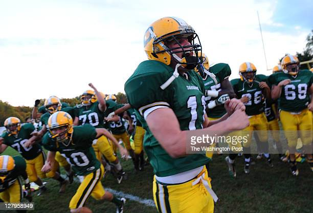 Damascus LB Dominic Frabrizio leads his team onto the field to play Sherwood on September 30 2011 in Damascus Md