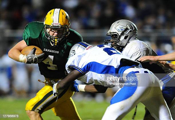 Damascus RB Caleb Baisden is stopped for a loss by Sherwood DB Abdoulie Jallow during 4th quarter action on September 30 2011 in Damascus Md