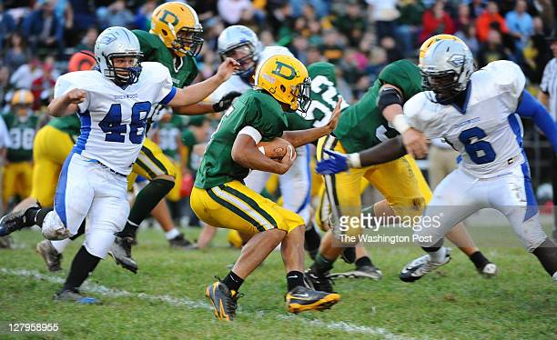 Damascus RB Trevor Patton is stopped behind the line of scrimmage by Sherwood defenders Blake Conrad and Fitz Mofor during 1st half action on...