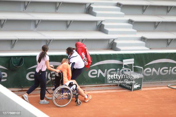 September 30. Kiki Bertens of The Netherlands is taken off the court in a wheel chair after winning her marathon match against Sara Errani of Italy...