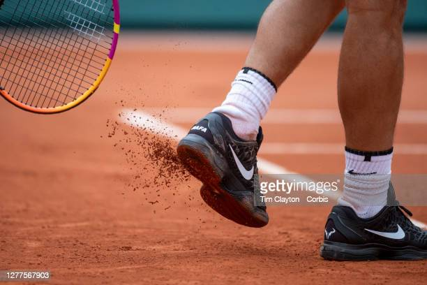September 30. Rafael Nadal of Spain knocks the clay off his shoes during his match against Mackenzie McDonald of the United States in the second...