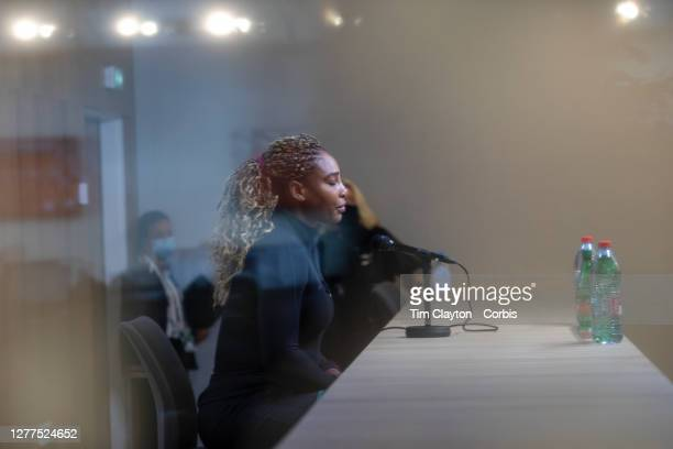 September 30. Serena Williams of the United States conducts a remote interview behind glass after pulling out of the tournament through injury during...