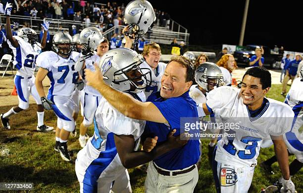 Sherwood Head Coach Mike Bonavia is mobbed by his players following their 143 win over Damascus on September 30 2011 in Damascus Md