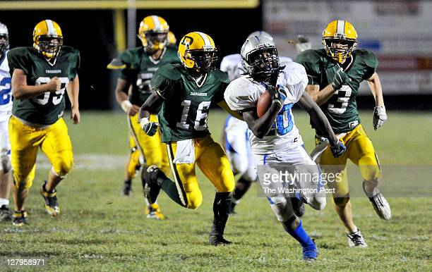 Sherwood RB Fernando Smith break free from Damascus defenders for a 39 yard touchdown run to seal their 143 win on September 30 2011 in Damascus Md