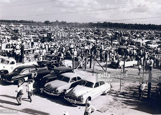 Fans fill the infield to capacity during the running of the first Southern 500 NASCAR Cup race at Darlington Raceway