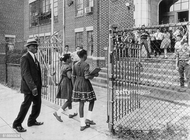 September 4 1963 Charleston SC Clarence Ford and his two small girls enter the gates of Simmons Elementary School for the integration of the previous...