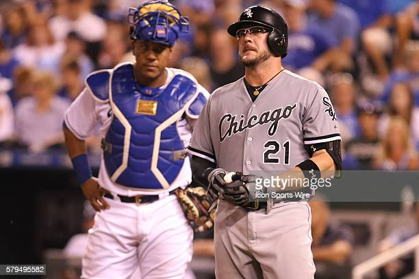 Chicago White Sox catcher Tyler Flowers is hit by a pitch as Kansas City Royals catcher Salvador Perez looks on during the game between the Chicago...