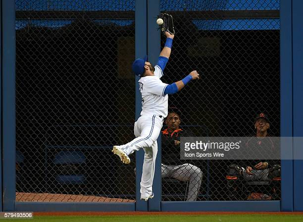 Toronto Jays right fielder Jose Bautista is unable to catch a ball hit for a double by Baltimore Orioles third baseman Ryan Flaherty in the second...
