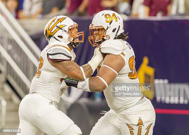 Arizona State Sun Devils linebacker Antonio Longino and Arizona State Sun Devils defensive lineman Demetrius Cherry celebrate during the AdvoCare...