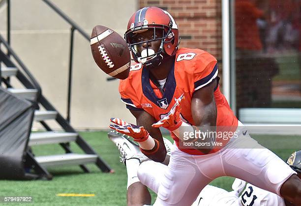 Illinois wide receiver Geronimo Allison attempts a pass reception in the endzone during a nonconference college football game between the Kent State...