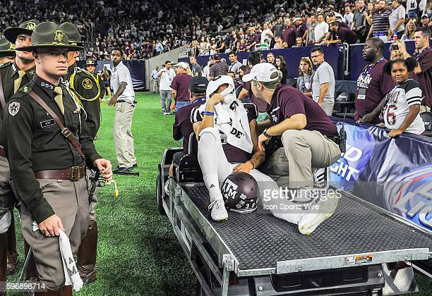 Texas AM Aggies punter Drew Kaser is carted off the field after a roughing the kicker call during second half action of the Arizona St Sun Devils vs...