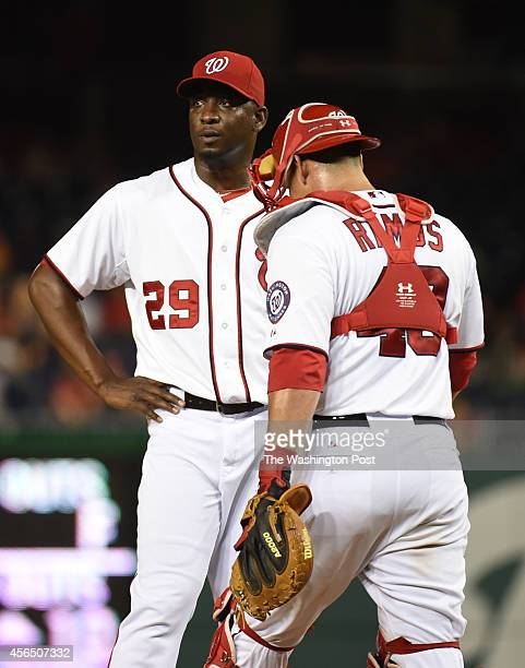 Washington Nationals relief pitcher Rafael Soriano looks on as catcher Wilson Ramos comes out to chat after he gave up a two run homer in the ninth...