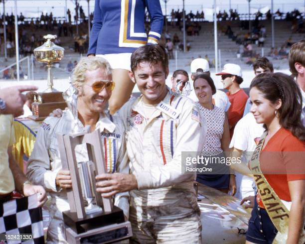 September 6, 1971: Marty Robbins joins Bobby Allison in victory lane at Darlington Raceway after Allison won the Southern 500 NASCAR Cup race....