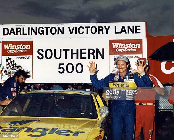 Dale Earnhardt raises 10 fingers in the air in victory lane at Darlington Raceway after winning the Southern 500 NASCAR Cup race his 10th Cup win of...