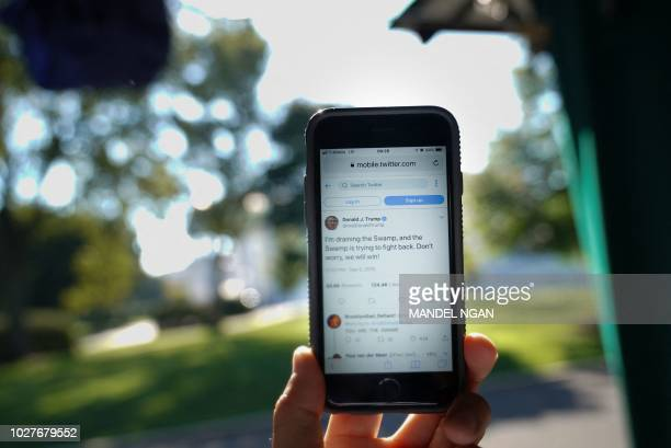 September 6 2018 illustration shows tweets from US President Donald Trump in response to an editorial in the New York Times outside of the White...