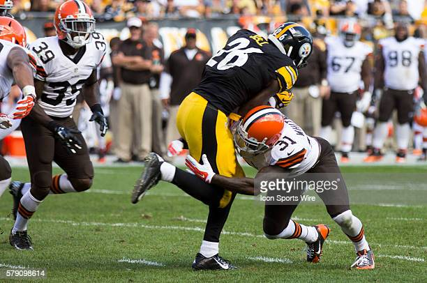 Cleveland Browns Safety Donte Whitner [13305] tackles Pittsburgh Steelers Running Back Le'Veon Bell [18362] during the Cleveland Browns game versus...
