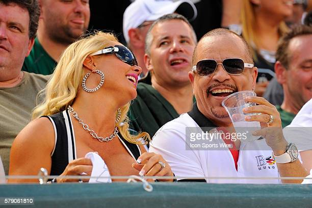 IceT right with wife Coco left during the second half of a NFL matchup between the Oakland Raiders and the New York Jets at MetLife Stadium in East...