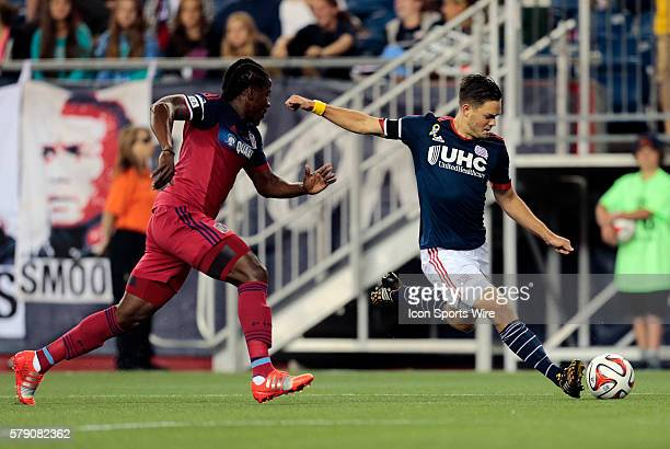 New England Revolution's Kelyn Rowe gets past Chicago Fire's Lovel Palmer and shoots The New England Revolution defeated the Chicago Fire 21 in a...