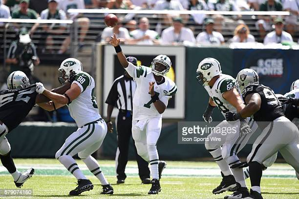 New York Jets quarterback Geno Smith airs out a pass during the first half of a NFL matchup between the Oakland Raiders and the New York Jets at...