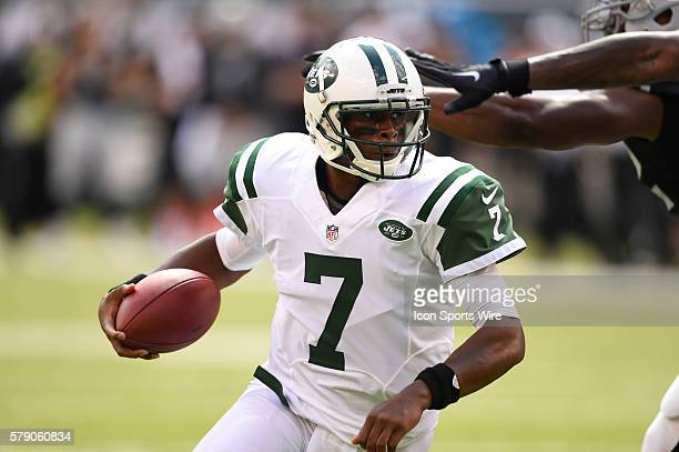 New York Jets quarterback Geno Smith runs out of the pocket during the second quarter of a NFL matchup between the Oakland Raiders and the New York...
