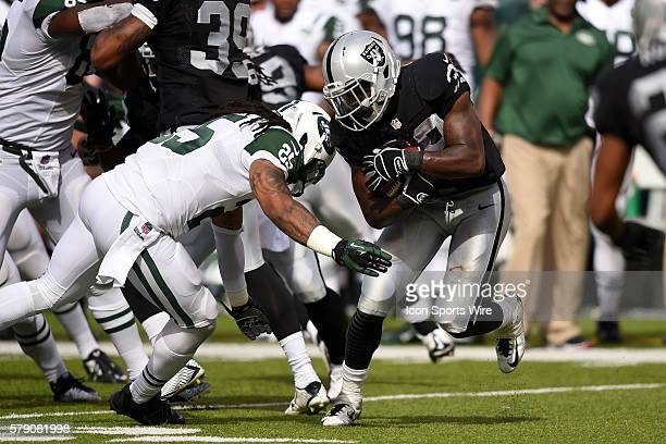 Oakland Raiders cornerback TJ Carrie is tackled by New York Jets free safety Calvin Pryor during the second half of a NFL matchup between the Oakland...