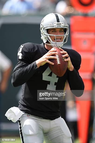 Oakland Raiders quarterback Derek Carr drops back to pass during the first quarter of a NFL matchup between the Oakland Raiders and the New York Jets...