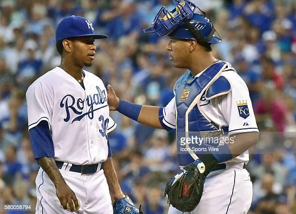 Kansas City Royals' catcher Salvador Perez talks with Kansas City Royals' starting pitcher Yordano Ventura during an MLB game between the Minnesota...