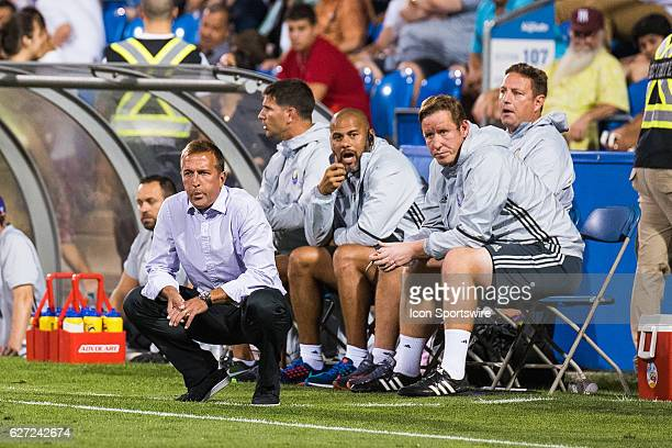Orlando coach Jason Kreis with his staff in the background during the Orlando City SC versus the Montreal Impact game at Stade Saputo in Montreal QC