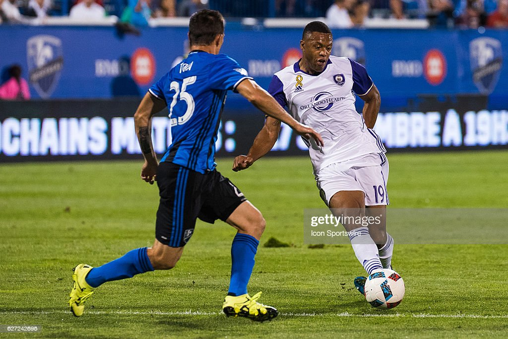 Orlando Julio Baptista (19) on the attack while Impact Donny Toia (15) tries to stop him during the Orlando City SC versus the Montreal Impact game at Stade Saputo in Montreal, QC