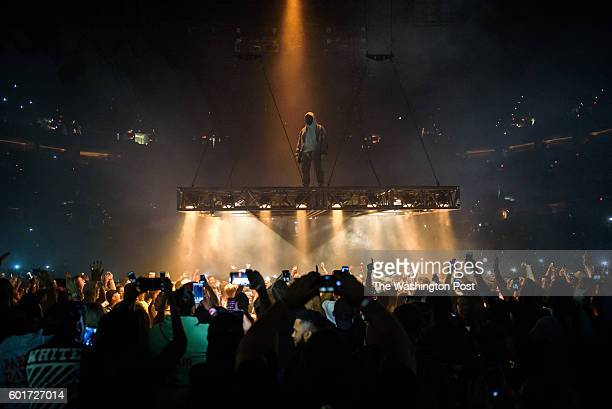 C September 8th 2016 Kanye West performs at the Verizon Center in Washington DC as part of his Saint Pablo Tour West spent the show suspended above...