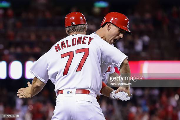 St Louis Cardinals Right fielder Stephen Piscotty [9782] is congratulated by St Louis Cardinals third base coach Chris Maloney on his two run home...