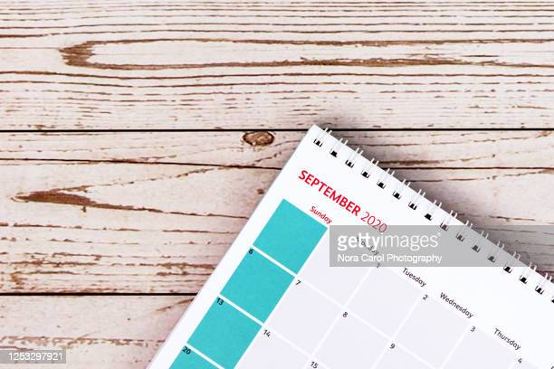 september calendar on wood background - september stock-fotos und bilder