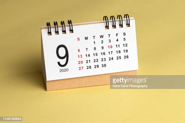 september calendar on yellow background - september stock-fotos und bilder