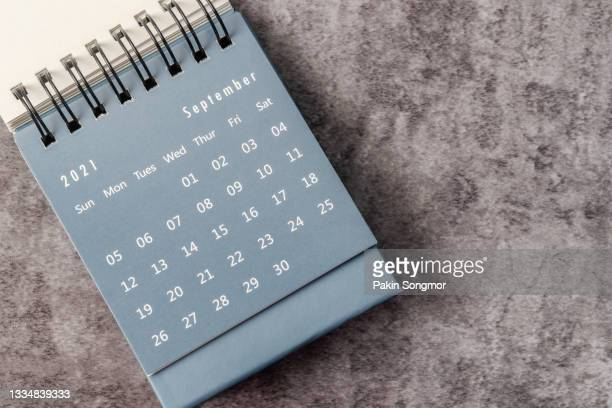 september month, calendar desk 2021 for organizer to planning and reminder on the table. business planning appointment meeting concept - september stock pictures, royalty-free photos & images