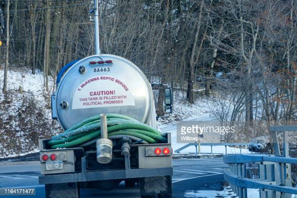 septic service tanker truck sign - political promises are poop - septic tank stock photos and pictures
