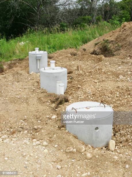 septic tank system with manhole covers - septic tank stock photos and pictures
