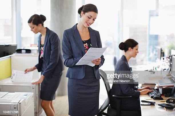 sequence of businesswoman working in office - cloning stock pictures, royalty-free photos & images