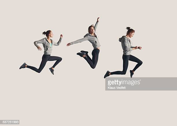 sequence of female runner in the air - jumping stock pictures, royalty-free photos & images