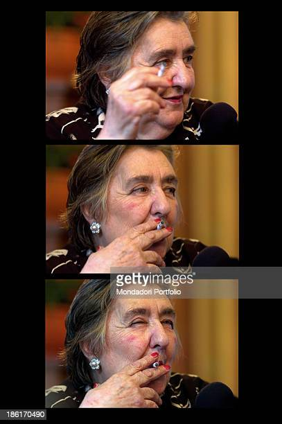A sequence of frames showing Italian poetess and writer Alda Merini smoking a cigarette The honorary citizenship was bestowed to the poetess by the...